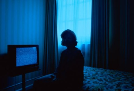 getty_rm_photo_of_woman_in_dark_hotel_room